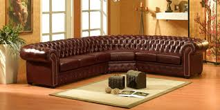 Какой диван лучше кожаный или тканевый?  фото