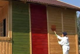 Как правильно покрасить деревянный дом снаружи? фото