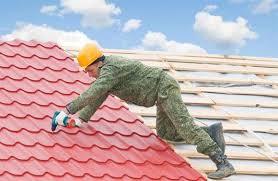 Как положить металлочерепицу на крышу? фото