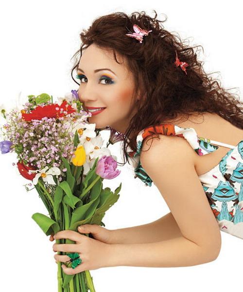 Какие цветы подарить девушке раку? фото