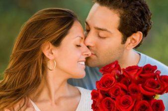 Hispanic-man-giving-flowers-to-wife