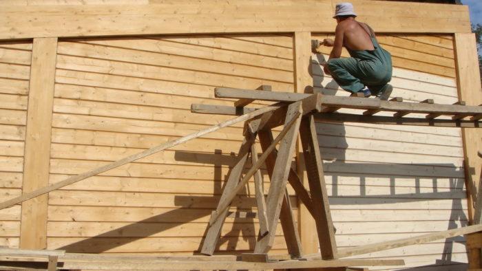 Как правильно покрасить фасад деревянного дома? фото