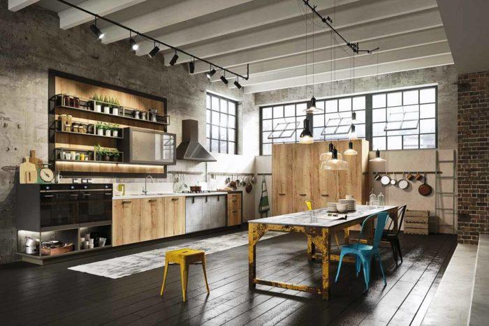 Бетонные стены и нарочито грубая мебель на кухне в стиле лофт