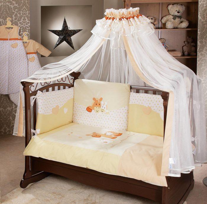 Как обустроить кроватку для новорожденного? фото