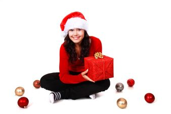 9126-a-beautiful-young-woman-with-a-christmas-gift-on-a-white-background-pv