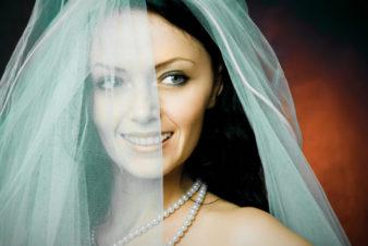 beautiful happy brunette bride wearing a veil